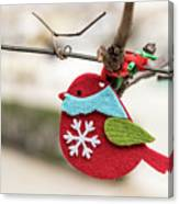 Small Red Handicraft Bird Hanging On A Wire Canvas Print