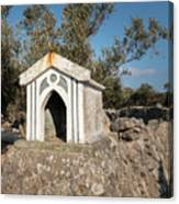 Small White Chapel On A Stone Wall Near Cres Canvas Print