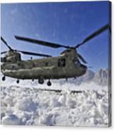 Snow Flies Up As A U.s. Army Ch-47 Canvas Print