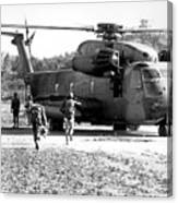 Soldiers Run To A Hh-53c Helicopter Canvas Print