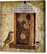 Sparrow On The Feeder Canvas Print