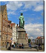 Statue Of Jan Van Eyck Beside The Spieglerei Canal In Bruges Canvas Print