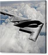 Stealth Bomber Over The Clouds Canvas Print