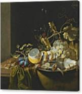 Still Life Of Hazelnuts Grapes Oysters And Other Foods On A Draped Table Canvas Print