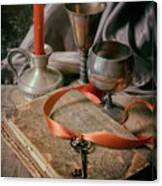 Still Life With Old Book And Metal Dishes Canvas Print