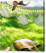Straw Hat With Brown Ribbon Laying On Hammock Canvas Print