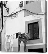 street in Porto with hanging clothes Canvas Print