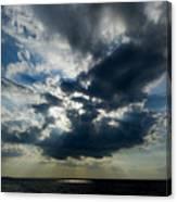 Sun Rays Through Clouds Form A Spot Canvas Print