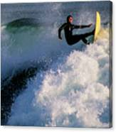 Sunset Surfing Canvas Print