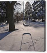 Swing Shadow On Snow Canvas Print