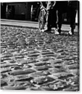Taking On The Cobbles Canvas Print