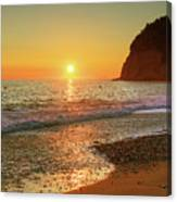the beach and the Mediterranean sea in Montenegro in the summer at sunset Canvas Print