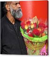 The Flower Vendor - Man Selling Roses Canvas Print