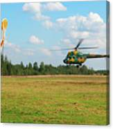 The Helicopter Over A Green Airfield. Canvas Print