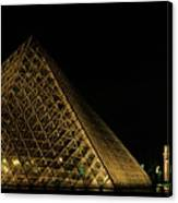 The Louvre Pyramid And The Arc De Triomphe Du Carrousel At Night Canvas Print