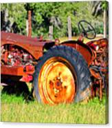 The Old Tractor In The Field Canvas Print