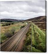 The Railroad To....in Scotland With Clouds Hanging Over The Mountains. Canvas Print