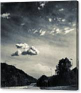 The Road And The Clouds Canvas Print