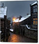 The Village Of Heptonstall In The Snow At Night With Lamps Shini Canvas Print