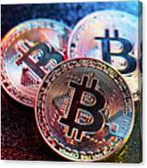 Three Bitcoin Coins In A Colorful Lighting. Canvas Print