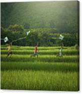 Three Boys Are Happy To Play Kites At Summer Field In Nature In  Canvas Print