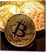 Three Golden Bitcoin Coins On Black Background. Canvas Print