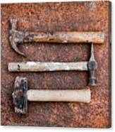 Three Hammers Against A Rust Background Canvas Print