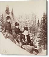 Three Tobogganers On A Snowy Hill Canvas Print