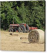 Tractor In The Hay Field Canvas Print