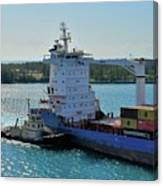 Tugboat Helping Container Ship Out Of Harbor Canvas Print
