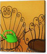 Two Black Iron Chairs And A Green Watering-can  Laid  On The Big Canvas Print