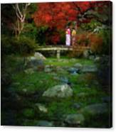 Two Girls In Kimono Standing On A Bridge In Japanese Garden In A Canvas Print