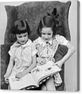 Two Girls Reading A Book, C.1920-30s Canvas Print