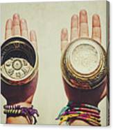 Two Hands Holding And Showing Both Sides Of Decorated Tibetan Singing Bowls Canvas Print
