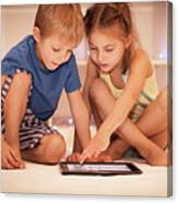 Two Happy Children Playing On The Tablet Canvas Print