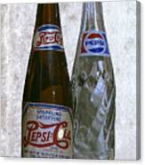 Two Pepsi Bottles On A Table Canvas Print