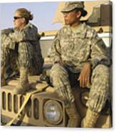 Two U.s. Army Soldiers Relax Prior Canvas Print