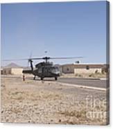 Uh-60 Black Hawk Helicopter Lands Canvas Print