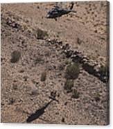 Uh-60 Black Hawk Hovers Above U.s Canvas Print