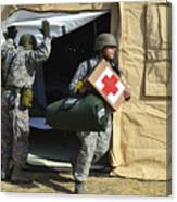 U.s. Air Force Soldier Exits A Medical Canvas Print