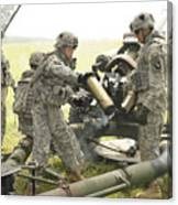 U.s. Army Soldier Throws A Spent 105mm Canvas Print