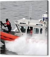 U.s. Coast Guardsmen Aboard A Security Canvas Print