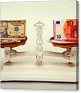 U.s. Dollar And Euro Banknotes On A Pair Of Scales In Vienna Canvas Print