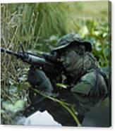 U.s. Navy Seal Crosses Through A Stream Canvas Print