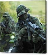 U.s. Navy Seals Cross Through A Stream Canvas Print