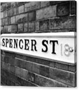 victorian metal street sign for spencer street on red brick building in the jewellery quarter Birmin Canvas Print