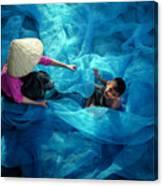 Vietnamese Women Repair Fishing Net And Fish Nets. Canvas Print