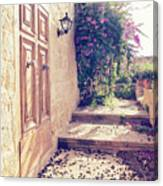 View Of The Cozy Patio With A Wooden Door And A Small Garden Canvas Print