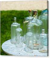 Vintage Glass Bottles On Table Canvas Print
