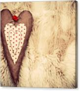Vintage Handmade Plush Heart Pillow On The Soft Blanket Canvas Print